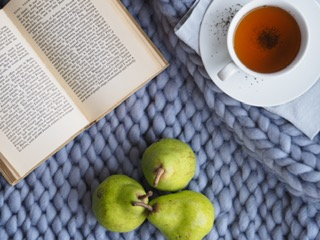 tea cup_book_pears on a blanket